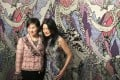 Pansy Ho Chiu-king (left), curator of the One Belt One Road Visual Arts Exhibition 2016, and Hong Kong fashion designer Vivienne Tam stand before a tapestry piece named Cultural Dreamland created by Tam.
