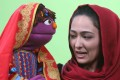 Afghan puppeteer Mansoora Shirzad with Sesame Street's new character, Zari. Photo: AP
