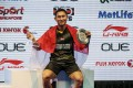 Sony Dwi Kuncoro of Indonesia shows off his spoils of victory after winning the men's singles title at the Singapore Open. Photo: EPA