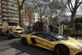 Super cars with a gold wrap finish are seen parked in a street in Knightsbridge in London on March 31, 2016. Photo: Reuters