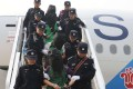 Police escort a group of telecom fraud suspects, including 45 Taiwanese, from an aircraft at Beijing Capital International Airport on April 13 after they were deported from Kenya. Photo: Xinhua