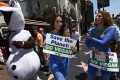 Peta campaigners deliver their Earth Day message this year, in Hollywood, California. Photo: AFP