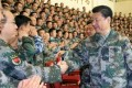 Xi Jinping wears a camouflage uniform at the PLA's new joint operation command. File Photo