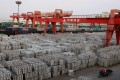 An aluminium ingots depot in Wuxi, Jiangsu province. China's excess capacity problem is which was fuelled by cheap financing and government subsidies over the past few years, says Rusal. Photo: Reuters