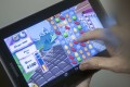 Puzzle games such as Candy Crush Saga are among the most popular with players in China, and mobile gaming is set to become the most lucrative segment of the market, according to a new report. Photo: Corbis
