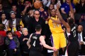 Actor Jack Nicholson watches from his courtside seat as Kobe Bryant plays in his last game for the Lakers. Photo: AFP