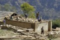 Nepalese workers rebuild in Ramechhap, an area damaged by the earthquake last year. Photo: AFP