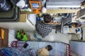 A woman and her son in their 60 sq ft subdivided flat, with a monthly rent of HK$3,800. Photo: Reuters