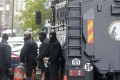 Members of French special police forces of Research and Intervention Brigade stand next to an armoured vehicle parked in front of the courthouse in Paris on April 27, 2016 as Salah Abdeslam, suspected of playing a major part in November's attacks in Paris by Islamist militants in which 130 people were killed, has been extradited to France from Belgium, prosecutors in both countries said on Wednesday. Photo: Reuters