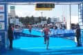 Hong Kong's James Tan crosses the finish line to win the men's junior event at the Asian Triathlon Championships in Hiroshima. Photo: SCMP Pictures