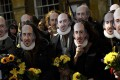 People wearing Shakespeare masks during celebrations to mark the 400th anniversary of the playwright's death in the town of his birth, Stratford-Upon-Avon, Britain. Photo: Reuters