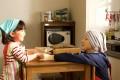 Ryoko Hirosue (right) and Emina Akamatsu play mother and daughter in Hana's Miso Soup (category I; Japanese). Directed by Tomoaki Akune, the film also stars Kenichi Takito.