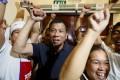 Philippine presidential candidate Rodrigo Duterte being cheered by the kitchen staff of a restaurant in Manila. Photo: AP