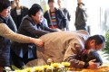 Family members mourn Wei Zexi, the 21-year-old Chinese student who died from cancer, at his funeral in Xianyang, Xian in northwestern Shaanxi province. Photo: China Foto Press