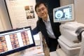 Professor Benny Zee demonstrates how the imaging system works. Photo: David Wong