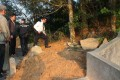 Police officers investigate a raided tomb at Hang Hau Village. Photo: SCMP Pictures