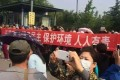 Crowds take to the streets to protest against the proposed petrochemical plant. File photo