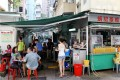 Hong Kong's street-food stalls may be getting thin on the ground thanks to officialdom's refusal to issue new licences, but recognition has come for the dai pai dong with the term's incorporation into the Oxford English Dictionary. Photo: Edward Wong