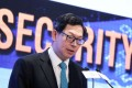 Norman Chan, chief executive of the Hong Kong Monetary Authority, at the Cyber Security Summit in Hong Kong. Photo: K .Y. Cheng