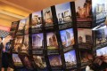 Visitors look at a brochure during an event in Beijing showcasing luxury properties from more than 35 countries, including Australia, Canada, Spain, Uruguay, and the United States. Photo: EPA