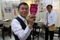 Lun Chi-keung, 58, and Ko Tat-kwan, 60, employees at Tai Choy Lee mahjong parlour on Kam Wing Street in San Po Kong. Photo: Nora Tam