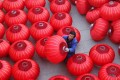 A villager airs red lanterns in Xingtai City, north China's Hebei province, famous for lantern production. Photo: Xinhua