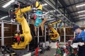 Industrial robots at work in Kunshan Daya Auto Parts Company. Photo: SCMP Pictures