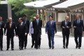 World leaders kicked off two days of G7 talks with a visit to the Shinto religion's most important shrine on Thursday. Photo: AFP