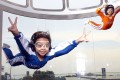 Kids take flight in Siloso's iFly Singapore, the world's largest themed wind tunnel for indoor skydiving.