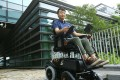Alan Lee, inventor and director of B-Free Technology, with his stair-climbing wheelchair at Science Park. Photo: Edmond So