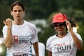 Naina, who has been in Hong Kong for 12 years after fleeing violence in her community in South Asia, runs with Virginie Goethals, Hong Kong director of the Free to Run charity. Photos: AFP