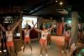 Employees dancing at Hooters in Bangkok, Thailand.