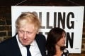 Former London mayor Boris Johnson and wife Marina Wheeler arrive at a polling station in north London on Thursday. Photo: AFP