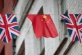 Chinese and British flags fly in London's Chinatown. Photo: Suzanne Plunkett, Reuters