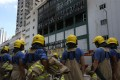 Firemen battled heavy smoke and flames as they broke open each storage cubicle inside the building. Photo: Sam Tsang