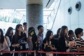 Real estate agents waiting last weekend for potential buyers outside the sales office of Park Yoho Venezia, a residential property developed by Sun Hung Kai Properties Ltd in Hong Kong. Anthony Kwan, Bloomberg