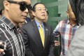 Lim Guan Eng (centre) being taken from his office in Penang by the Malaysian Anti-Corruption Commission. Photo: AP