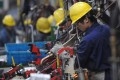 China's manufacturing purchasing managers index (PMI) for June stood at 50, down slightly from 50.1 in May. Photo: Xinhua