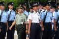 The chief the PLA's Hong Kong garrison, Tan Benhong, inspects the new police recruits. Photos: Felix Wong