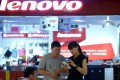 Better known for its computer and smartphone products, Lenovo has made a move into the shared economy via an investment in WeWork. Photo: AFP