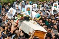 Mourners carry the coffin of Abbas Kiarostami on July 10 in the Iranian capital ahead of his funeral in the town of Lavasan. Photo: AFP