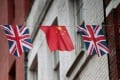 Chinese and British flags fly in London's Chinatown. Photo: Reuters