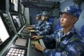 Chinese navy sailors search for targets on board the missile destroyer Hefei during a military exercise in the waters near Hainan Island and the Paracel Islands. Photo: AP