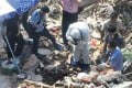 Police investigate the wreckage of a forcibly demolished house in Changsha where a body was found. Photo: SCMP Pictures