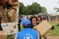 World Food Programme (WFP) staff prepare high-energy biscuits for distribution at the United Nations Mission in South Sudan (UNMISS) compound in Tomping. Photo: Reuters