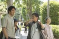 Hirokazu Koreeda (centre) directs Hiroshi Abe (left) and Kirin Kiki on the set of After the Storm.