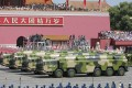 Military vehicles carry DF-16 ballistic missiles in Tiananmen Square last September. Photo: Imaginechina