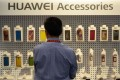Huawei phone accessories on display at the 2013 International CES at the Las Vegas Convention Center. The world's largest telecommunications equipment supplier now plans to open 15,000 new retail stores around the world this year. Photo: AFP