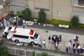 Ambulance crew and police officers are seen outside a facility for the handicapped in Sagamihara, outside Tokyo, where a mass stabbing took place on Tuesday. Photo: Kyodo