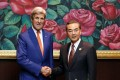 US Secretary of State John Kerry shakes hands with Foreign Minister Wang Yi on the sidelines of the Asean foreign ministers meeting in Vientiane, Laos, on Monday. Photo: Reuters